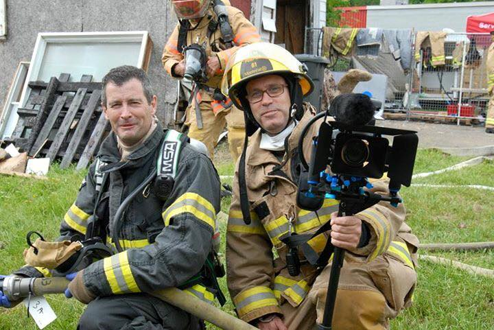 Bjorn Ulfsson (right) and international CFBT instructor John McDonough (Left) captured at a live house burn during the From Knowledge to Practice event in Mirabel, Montreal, Canada 2016. Photo by Terri Casella / BT Video Productions
