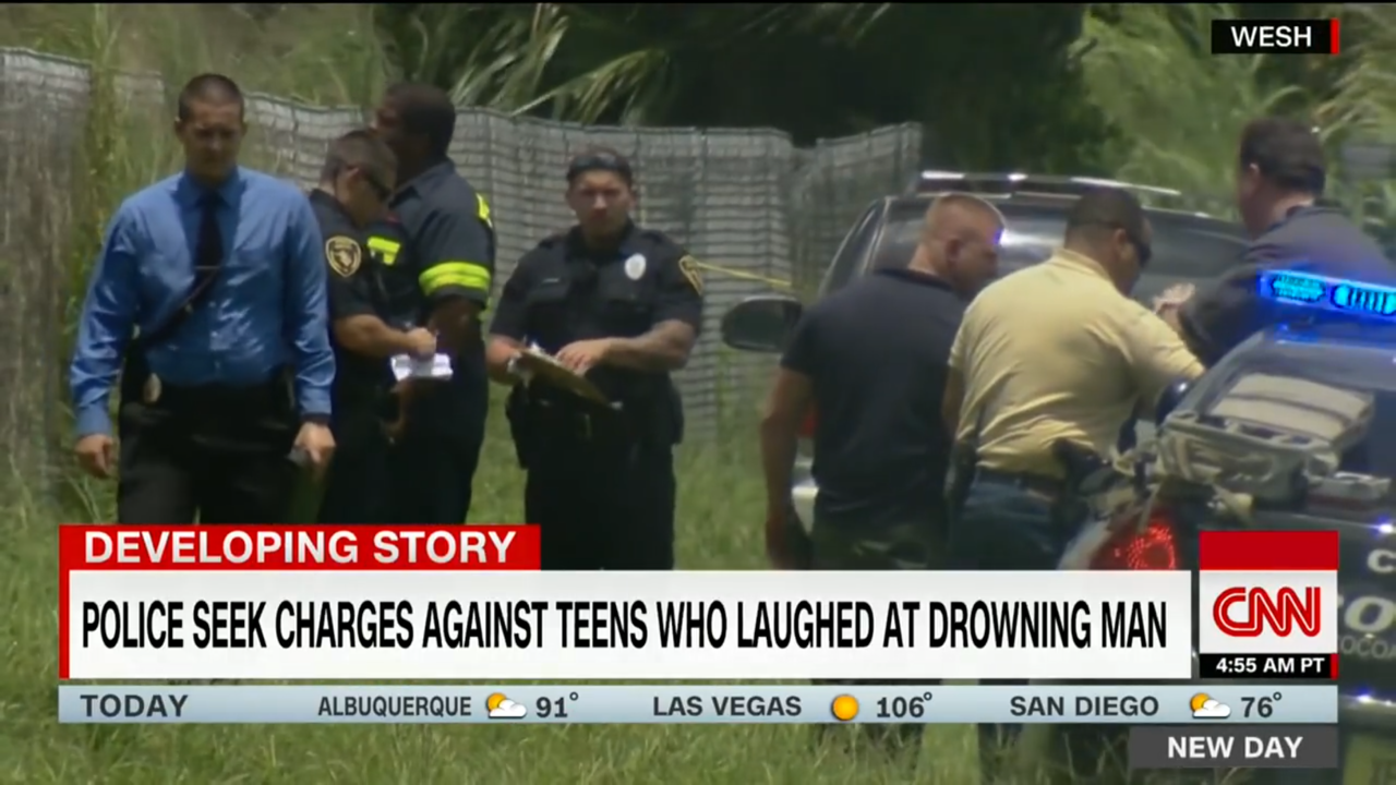 Police at the drownig scene where a 31-year old man was taunted and teesed by a group of teens who refused to helo and just let the man die. The teens video (see it above ) went viral on social media and poice have been trying to get theteens arrested since the event happened in July 2017.