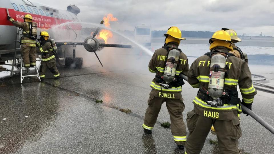 Members of the Fort Pickett Fire & Rescue Department conduct aircraft rescue training Oct. 13, 2017, at the Blackstone Army Airfield near Fort Pickett, Virginia. (U.S. National Guard photo by Cotton Puryear)