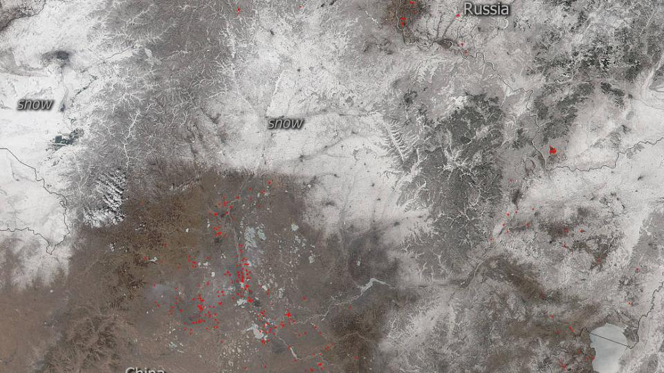 Snowfall and fire are juxtaposed in this Suomi NPP satellite image of China and Russian captured on March 21, 2018.  It is unclear whether these are deliberately set fires for the purpose of clearing fields for planting or if they are wildfires.  The fires span across the border from China to Russia.  Actively burning areas, detected by MODIS's thermal bands using the VIIRS (Visible Infrared Imaging Radiometer Suite) instrument, are outlined in red. NASA image courtesy Jeff Schmaltz LANCE/EOSDIS MODIS Rapid