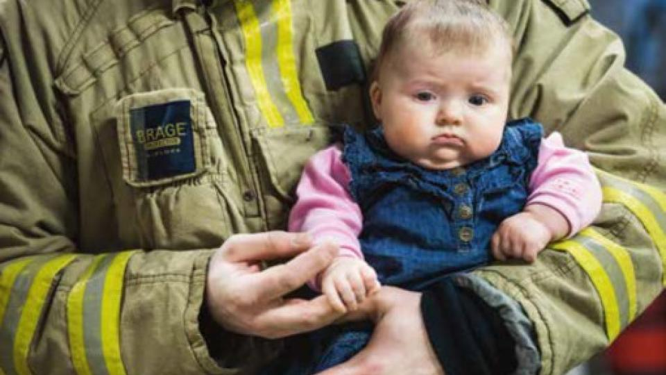 Baby and firefighter