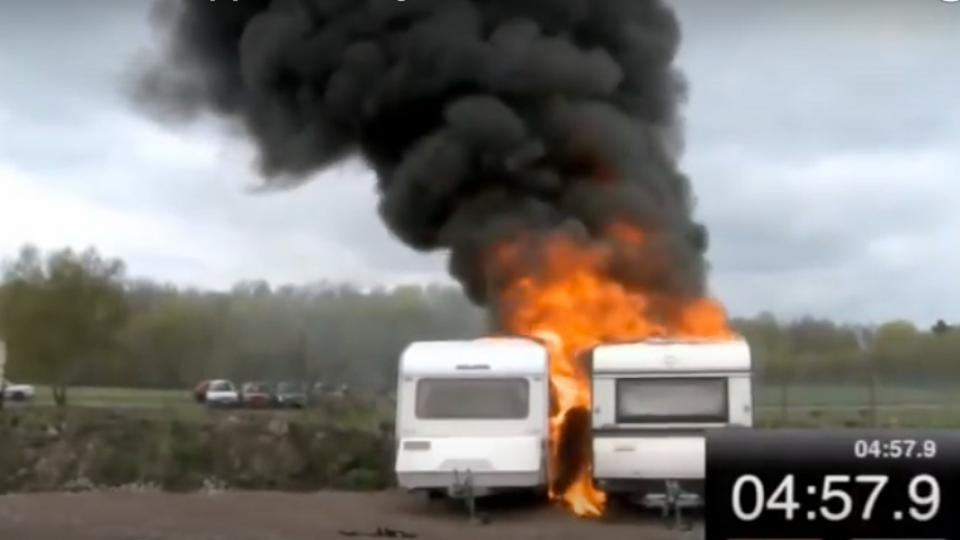 Two caravans on fire. Screenshot from video by MSB.se