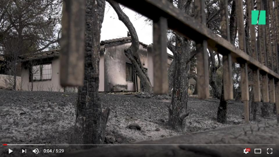 Burned building in Greece. Screen shot from Huffington Post.