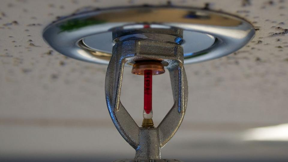 Fire sprinkler mounted on a roof. Photo by Wikipedia