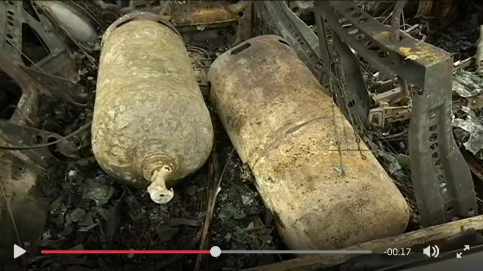 Propane bottles in the burned out cars. Photo: SVT