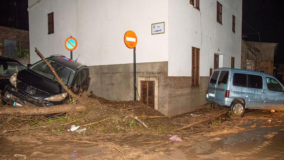 Cars thrown around by the moving water on Mallorca.