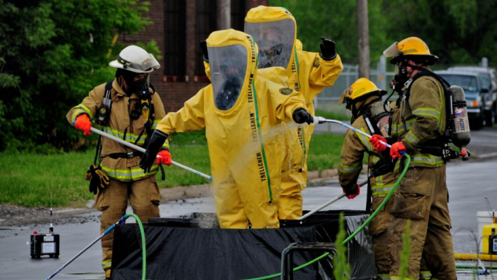Members of the Niagara Falls Air Reserve Station, N.Y., Fire Department lend support during a hazardous material spill at a chemical plant in the ciity of Niagara Falls on May 28, 2010. The base fire department has one of the best hazardous material handling teams in the Niagara Falls area. (U.S. Air Force photo/Staff Sgt. Joseph McKee)