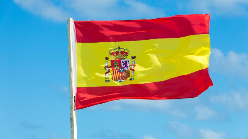Spanish flag on blue sky