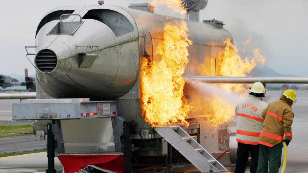 US Navy personnel using an aircraft fire trainer. Photo: Wikipedia