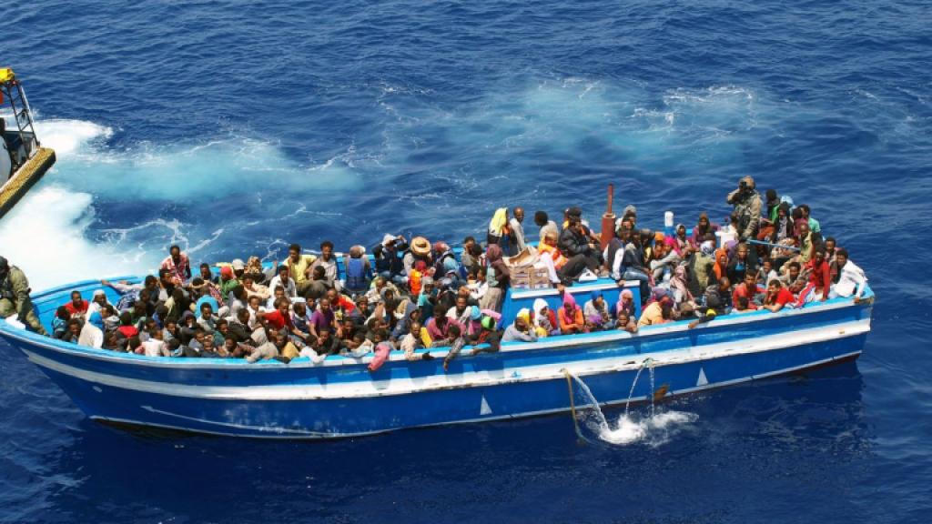 A cayuko filled with African migrants on the Mediterranean sea, intercepted by KBV 001 Poseidon / Photo by Swedish Coast Guard